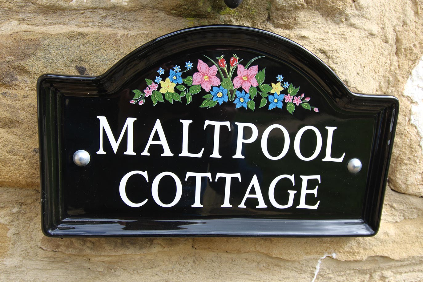 Maltpool Cottage exterior at Burradon Farm Houses & Cottages