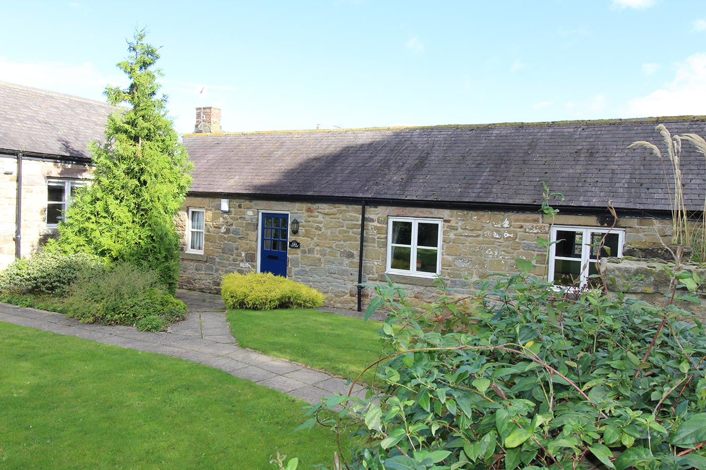 Forge Cottage front garden | Burradon Farm Houses & Cottages