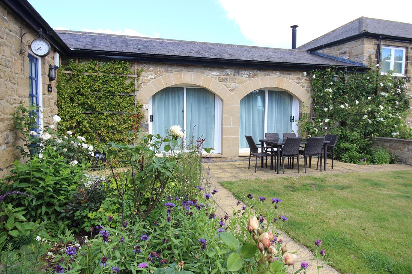 Wheatlands Cottage front private garden | Burradon Farm Houses & Cottages
